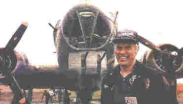 Photo of Wally in front of a B-17.