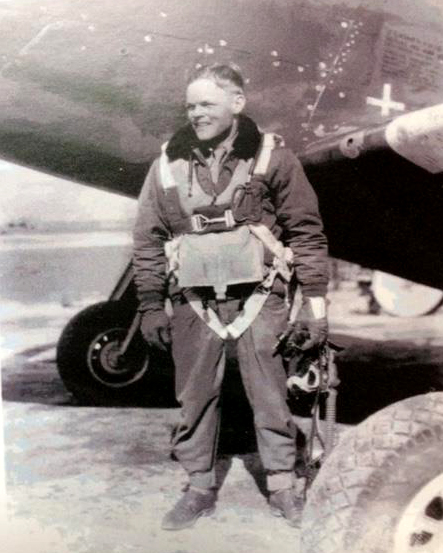 Photo of Irving by a plane in 1944.