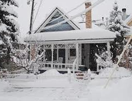 Photo of a house in the snow.